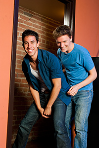 (Pictured left to right) Joshua Lomeli as Jesse and Erik Johnson as Daniel and in Fighting Mac! by John Fisher; a Theatre Rhinoceros production at Thick House Theatre. Photo by Kent Taylor.