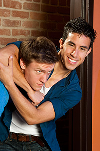 (Pictured left to right) Erik Johnson as Daniel and Joshua Lomeli as Jesse in Fighting Mac! by John Fisher; a Theatre Rhinoceros production at Thick House Theatre. Photo by Kent Taylor.