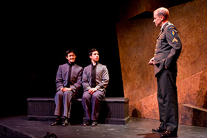 Elijah Guo as Tom, Joshua Lomeli as Jesse, and John Fisher as Capt. Franklin in Fighting Mac! by John Fisher; a Theatre Rhinoceros production at Thick House; Photo by Kent Taylor.