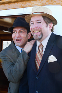 Pictured left to right: Rudy Guerrero* as Wilson Mizner and Bill Fahrner* as Addison Mizner in ROAD SHOW music and lyrics by Stephen Sondheim, book by John Weidman, directed by John Fisher, photo by Kent Taylor; A Theatre Rhinoceros Production at the Eureka Theatre.