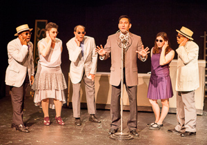 Pictured left to right: Ae'Jay Mitchell, Kathryn Wood, Kim Larsen, Rudy Guerrero* as Wilson Mizner, Kate McCarthy, and Justin Lucas in ROAD SHOW music and lyrics by Stephen Sondheim, book by John Weidman, directed by John Fisher, photo by David Wilson; A Theatre Rhinoceros Production at the Eureka Theatre. *Member Actors' Equity Association.
