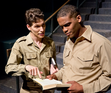 Pictured left to right: Gabriel A. Ross as Young Harry and Jesse F. Vaughn as Douglas in SHAKESPEARE GOES TO WAR by John Fisher; a Theatre Rhinoceros Production at Thick House Theater. Photo by David Wilson