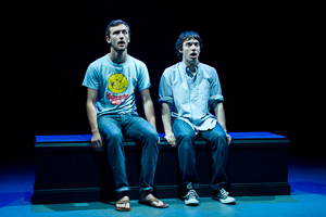 Pictured left to right: Robert Kittler as Marty and Ben Calabrese as Rory in Slugs and Kicks by John Fisher. A Theatre Rhinoceros production at Thick House. Photo by Kent Taylor. Action:  Marty and Rory enjoy the new James Bond picture.