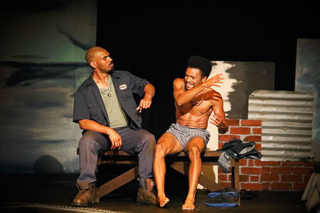 Pictured left to right: LaKeidrick Wimberly as Ogun and Gabriel Christian as Oshoosi in Tarrel Alvin McCraney's THE BROTHERS SIZE, directed by Darryl V. Jones ; A Theatre Rhinoceros Production at the Eureka Theatre; photo by Steven Ho.